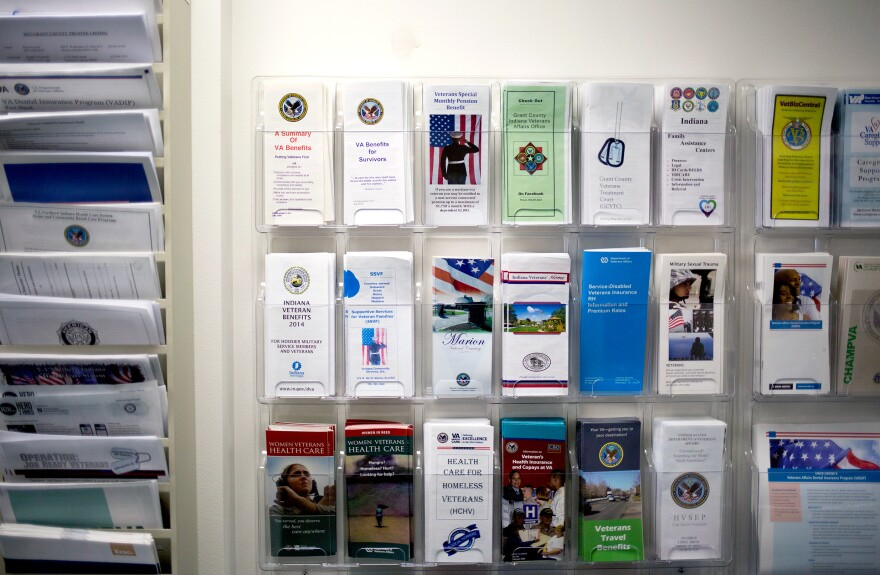 Pamphlets detailing services available to veterans are displayed in VSO Bob Kelley's office in Marion, Ind.