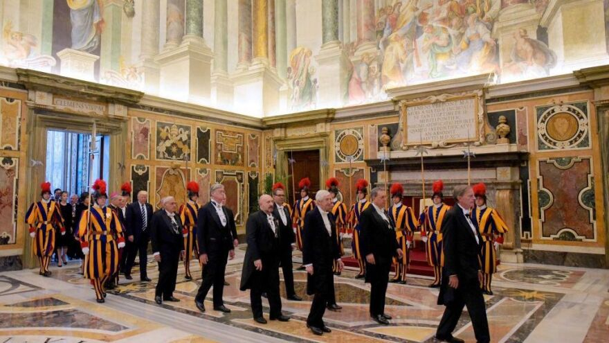 President Trump is welcomed by the prefect of the papal household Georg Gaenswein as he arrives at the Vatican for a private audience with Pope Francis on Wednesday.