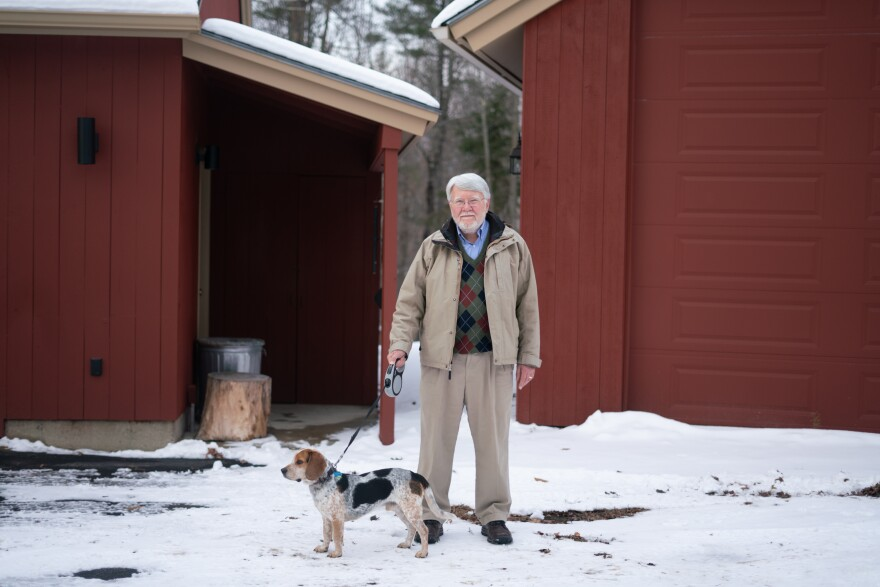 Randy Hayes with his recently adopted dog, Pirate, in Canterbury, N.H. Hayes, a retired physician, wants to see incremental change in the health care system, like that created by the Affordable Care Act.