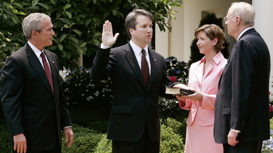 Brett Kavanaugh is sworn in by Kennedy to be a judge on the U.S. Circuit Court of Appeals in 2006. With him are his wife, Ashley, and President George W. Bush.