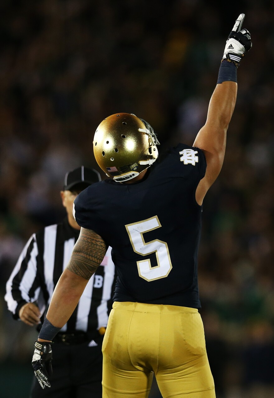 Manti Te'o, pointing skyward during Notre Dame's game against Michigan on Sept. 22. That was the day, he said then, of his girlfriend's funeral service. Now, he says he never met her and they had only an online and telephone relationship.