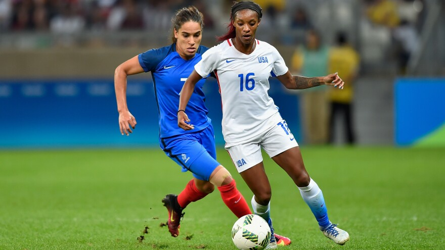 U.S. women's soccer player Crystal Dunn (in white) contends with Amel Majri of France during their match at Mineirao Stadium in Belo Horizonte, Brazil. The U.S. earned a 1-0 victory in the the Group G first-round meeting in the Rio Summer Olympics tournament.