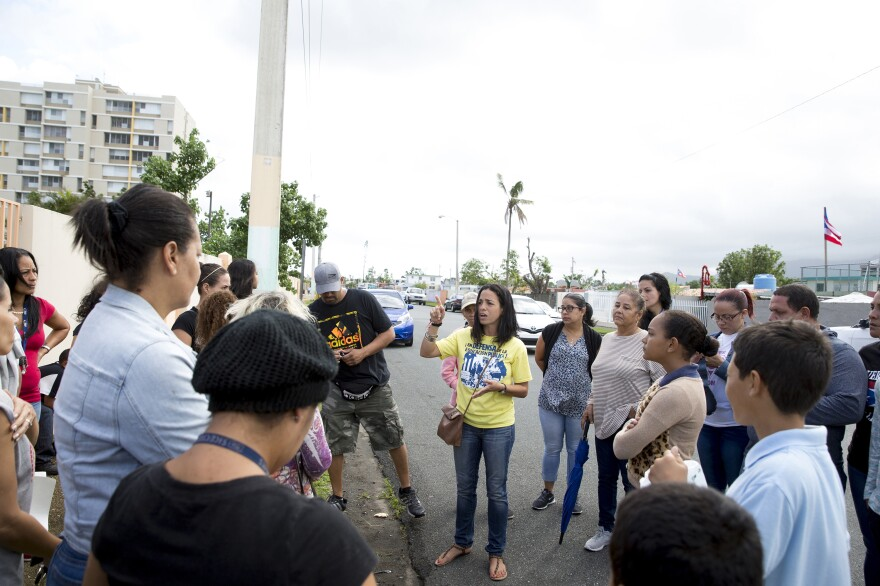 Middle school teacher Noelanie Fuentes (center) leads a protest against the students' relocation to a high school.