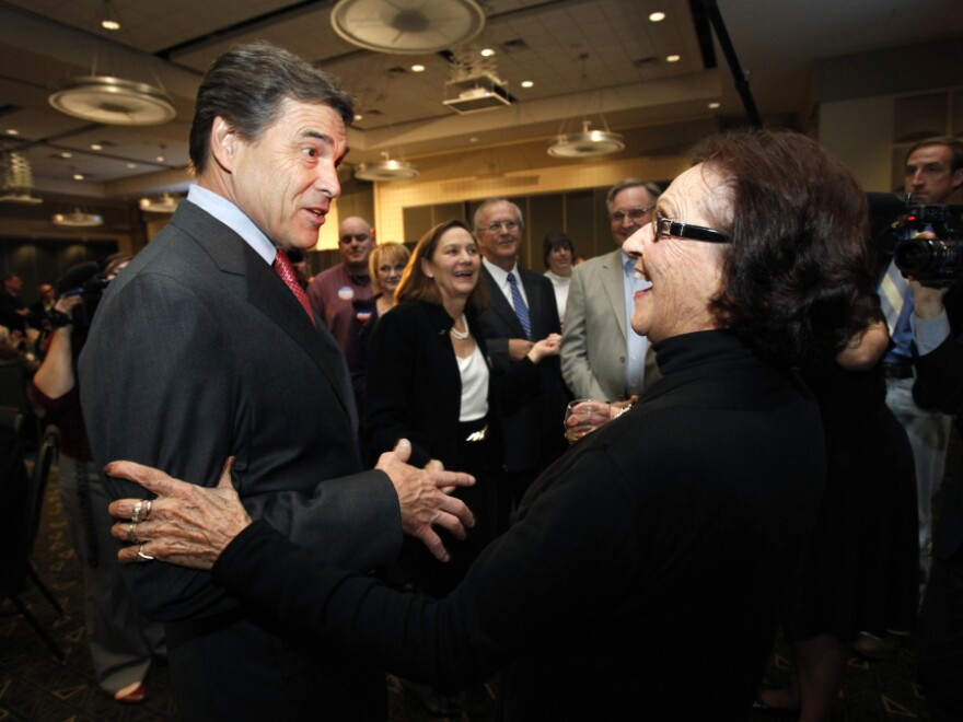 Republican presidential candidate Texas Gov. Rick Perry talks with voter Jane High before speaking at the Scott County Republican party's Ronald Reagan Dinner on Nov. 14 in Bettendorf, Iowa.