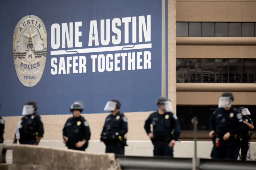 Austin police gather on I-35 in May to remove protesters demonstrating against police brutality off the highway. Gov. Greg Abbott and other state officials have criticized the city's decision to cut police funding.