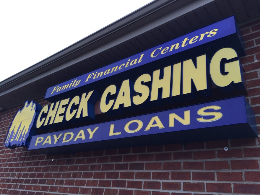 A photo of a Check Cashing Payday Loans storefront.