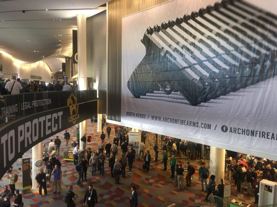 Attendees file into SHOT Show in Las Vegas. It's the largest gun industry event of the year and brings in manufacturers, buyers and even government officials from all over the world.