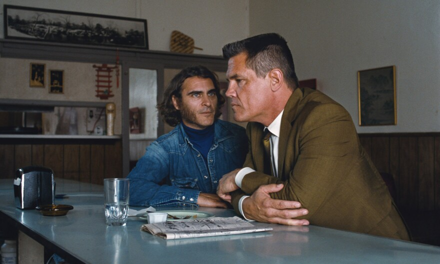 "In <em>Inherent Vice,</em> Joaquin Phoenix (left) plays a burned-out hippie private eye, while Josh Brolin is a Los Angeles Police Department detective --€"" Lt. Detective ""Bigfoot"" Bjornsen --€"" who is investigating a murder and kidnapping case."