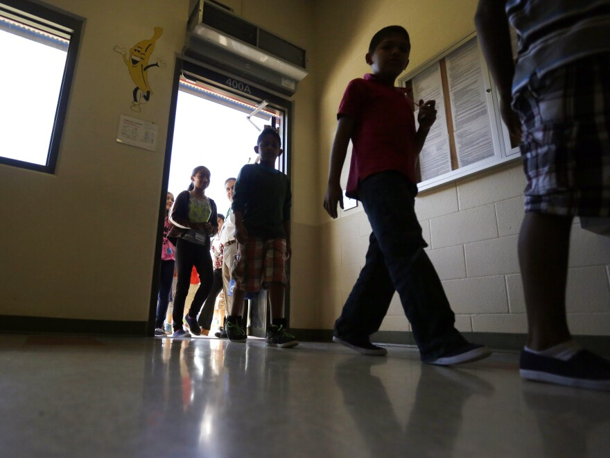 Detained immigrant children enter a cafeteria in Karnes City, Texas. The Trump administration stopped using the center to hold parents and children in March 2019.