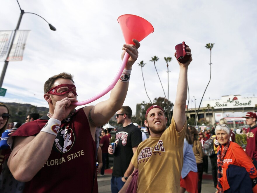 Students drink outside the Rose Bowl during the NCAA BCS national championship game in January.