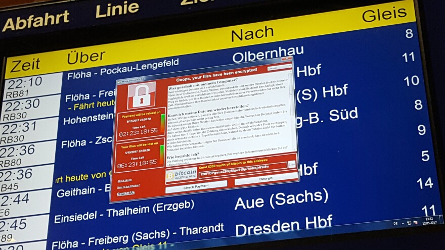 After the WannaCry cyberattack hit computer systems worldwide, Microsoft says governments should report software vulnerabilities instead of collecting them. Here, a ransom window announces the encryption of data on a transit display in eastern Germany on Friday.