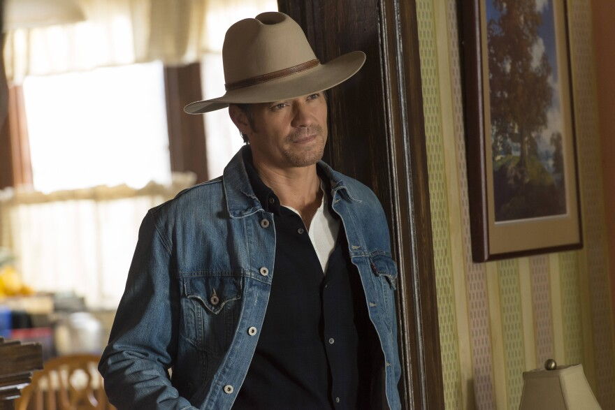 "Timothy Olyphant plays Deputy U.S. Marshal Raylan Givens on FX's <em>Justified</em>, which is based on a novella by Elmore Leonard. The show's creator, Graham Yost, says the only ""tussle"" the writers had with Leonard happened during the pilot, over which hat Raylan should wear."