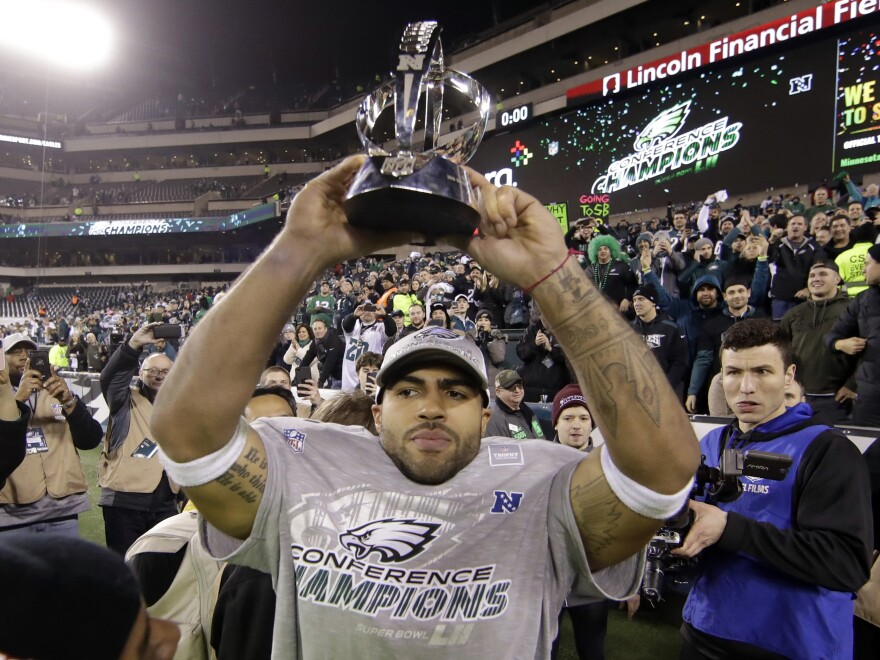 Philadelphia Eagles Mychal Kendricks holds the George Halas Trophy after the NFL football NFC championship game against the Minnesota Vikings yesterday in Philadelphia.