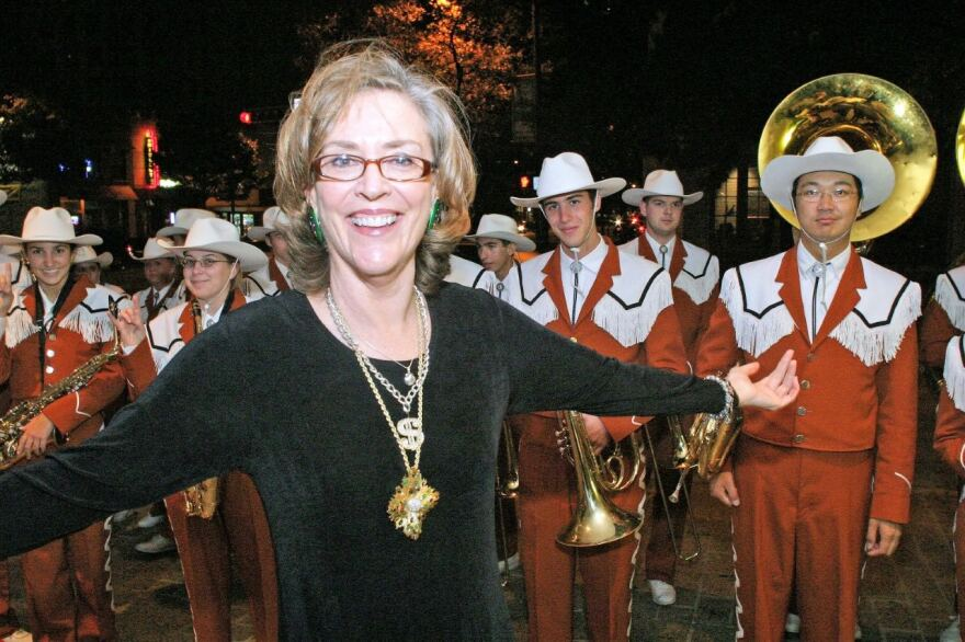 Sarah Bird and the Longhorn marching band.