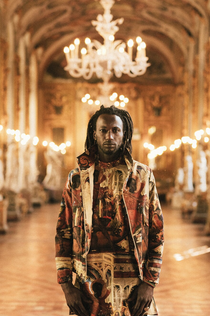"""Ousman Pa Manneh, originally from Gambia, models clothing by Ikiré Jones in Rome. """"No matter how beautifully we are dressed,"""" he said, """"we are considered a threat."""""""