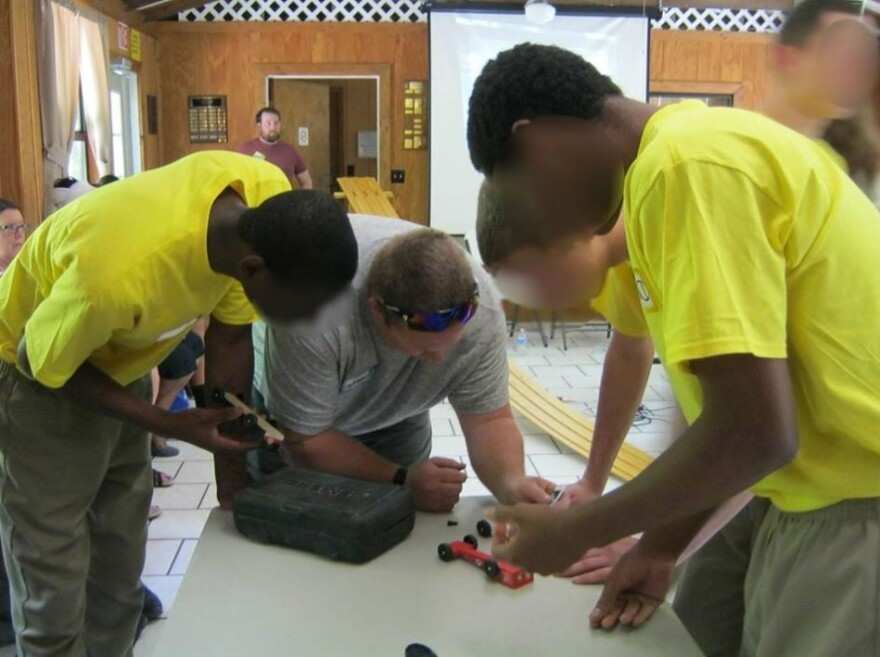 DJJ education staff preside over the inaugural Pinewood Derby Challenge between students at two of DJJ's residential facilities to design and build cars.