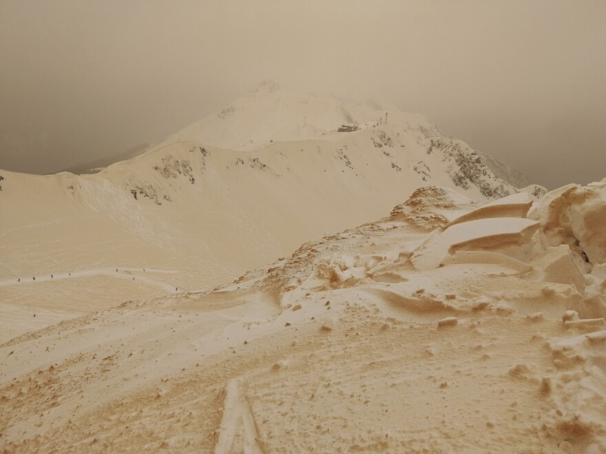 Orange snow in the mountains at the Rosa Khutor ski resort outside Sochi, Russia, on Friday.