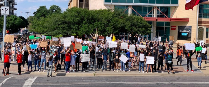 People were already gathered outside Dallas Police Headquarters shortly after 5 p.m. Monday.