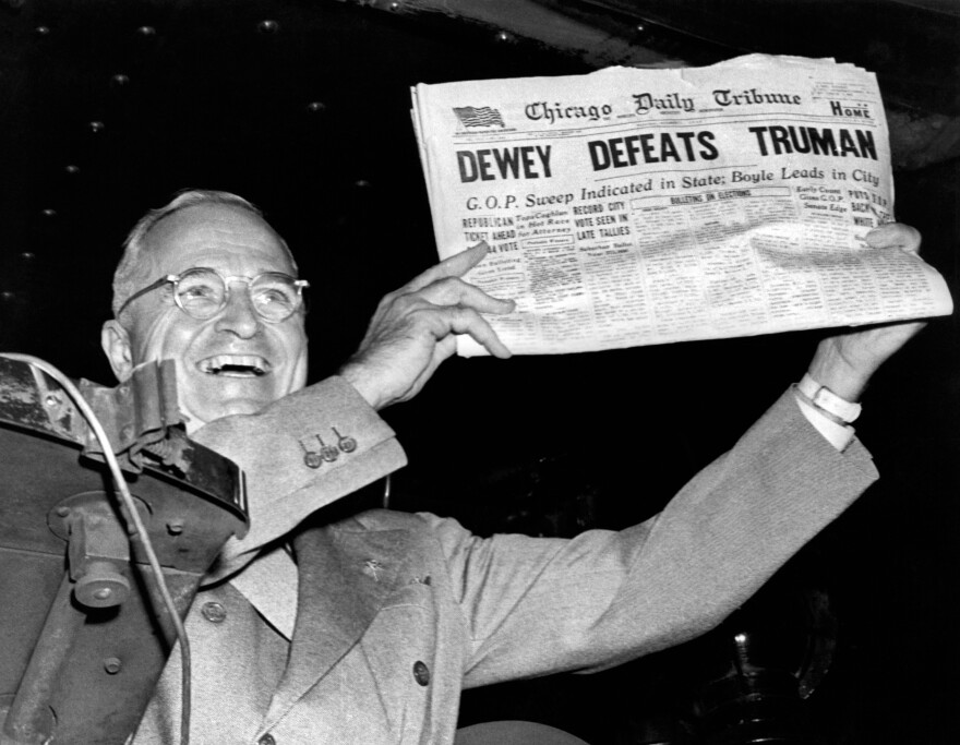 Jumping the gun: President Harry Truman holds up a copy of the <em>Chicago Daily Tribune</em> that erroneously declared his defeat by Thomas Dewey in the presidential election of 1948.