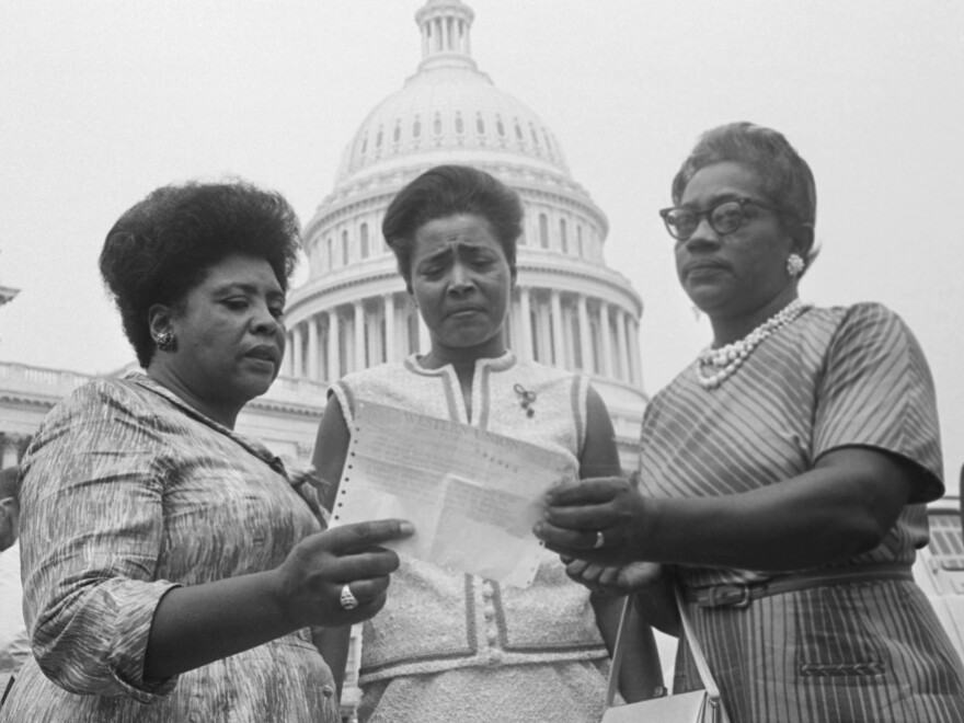 Fannie Lou Hamer, Victoria Gray and Annie Devine, Mississippi Freedom Democratic Party contestants for the state's seats, hold a telegram allowing them onto the House floor during debate.