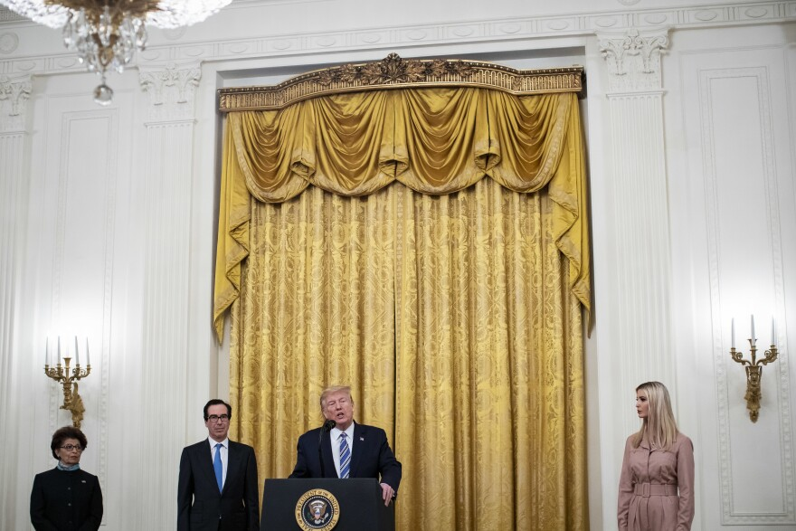 President Trump speaks as Jovita Carranza, administrator of the Small Business Administration; Treasury Secretary Steven Mnuchin; and Ivanka Trump, advisor to the president, listen during a Paycheck Protection Program event in the East Room of the White House on April 28, 2020.