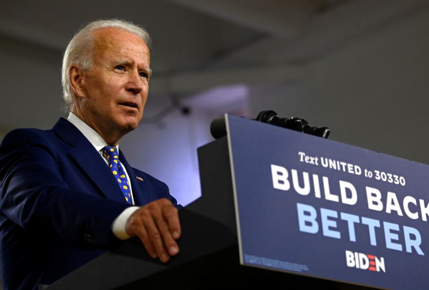 Presumptive Democratic nominee Joe Biden, seen here at a campaign event in July, says he won't tear down the border wall put in place during the Trump administration.