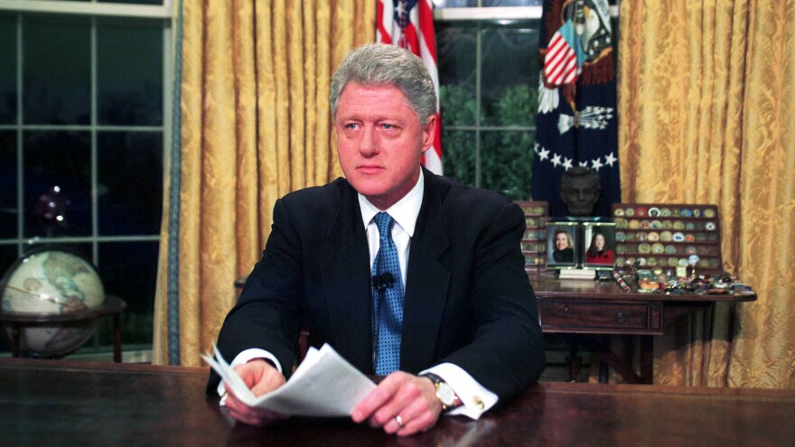 Then-President Bill Clinton is seen in the Oval Office after addressing the nation about the NATO bombing of Serb forces in Kosovo, on March 24, 1999.