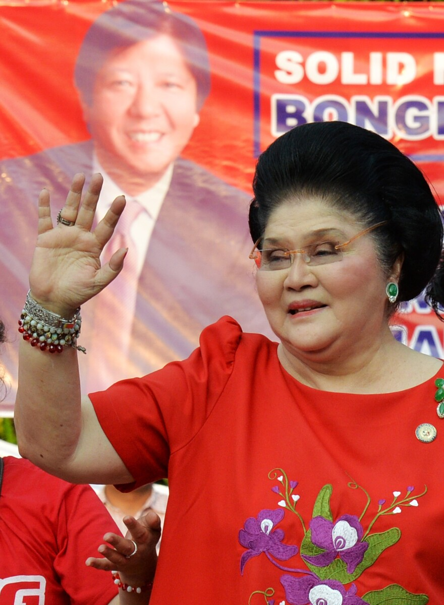 Former first lady Imelda Marcos — whose abandoned collection of thousands of shoes became notorious as a symbol of excess after her husband was deposed as leader in 1986 — waves to supporters after her son Ferdinand Marcos, Jr., announced his vice presidential bid. Imelda Marcos, meanwhile, is an incumbent running to keep her a seat in Congress.