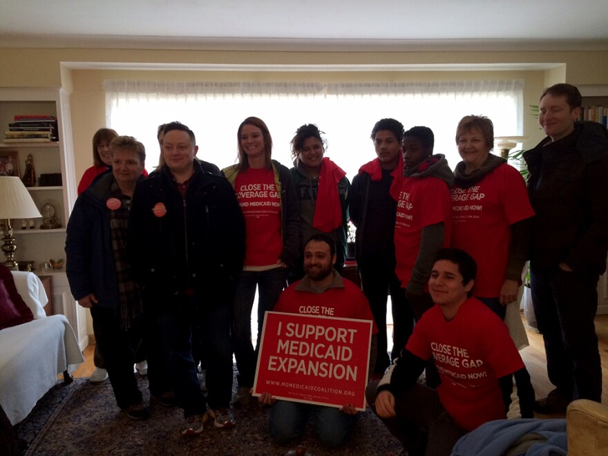 Medicaid expansion advocates stopped for a photo before splitting into small groups to canvass House Speaker John Diehl's district on January 31, 2015.