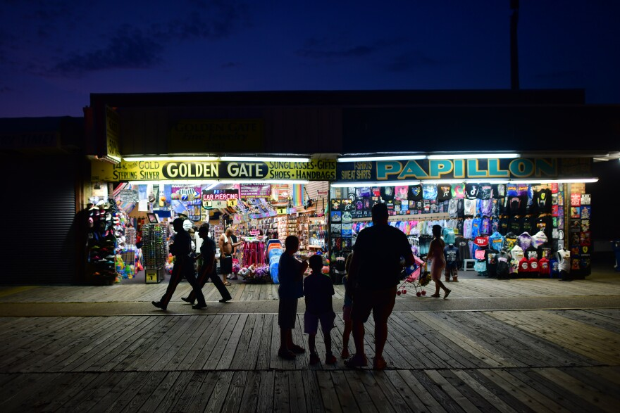 People walk the boardwalk in early July in Wildwood, N.J., after some coronavirus restrictions were lifted. There's concern that case counts could push back up in Mid-Atlantic and Northeastern states.