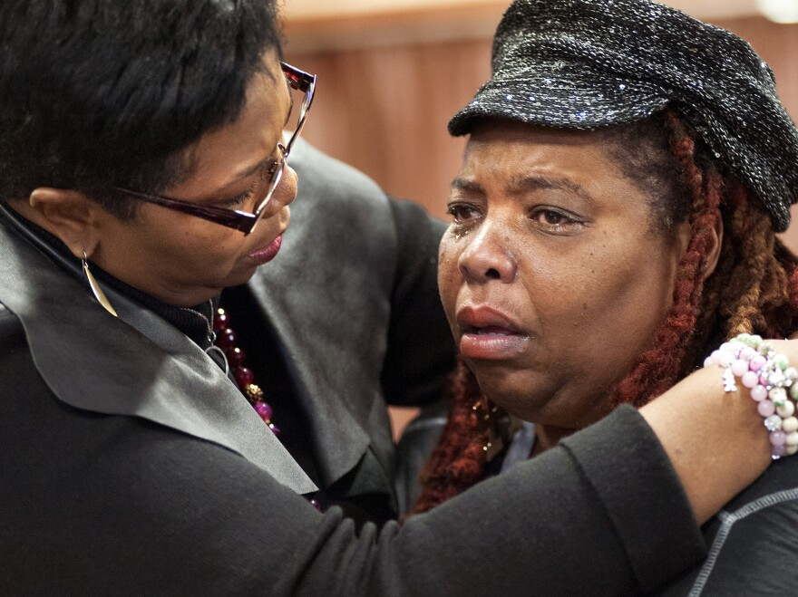 "Rev. Traci Blackmon, left, comforts Dell Taylor during the opening meeting of Missouri's Ferguson Commission in 2014. ""We've always had to figure out how to take care of our community, to take care of our neighborhoods and take care of our seniors,"" Blackmon says."