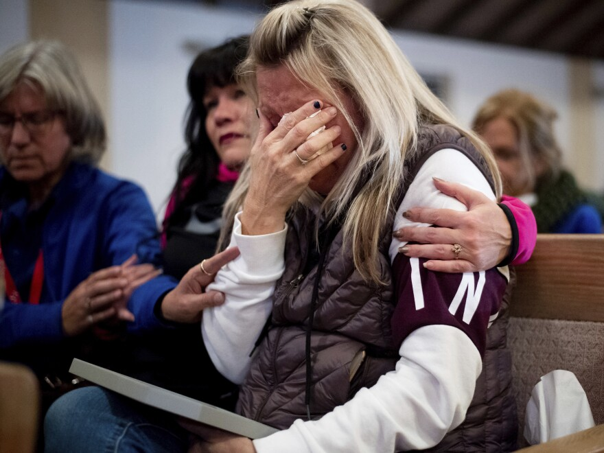 Laura Martin mourns her father, TK Huff, who died during the Camp Fire, during a vigil on Sunday in Chico, Calif.