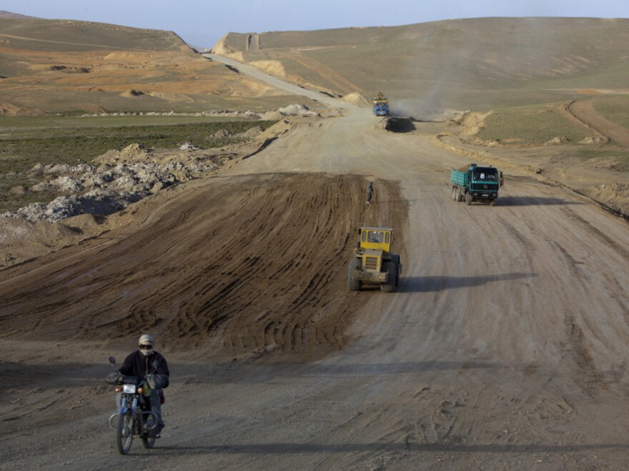 A motorcyclist rides along the still under construction Bamiyan-Yakawlang road in Yakawlang, Afghanistan, June 10. Despite the construction of new roads, many of them are unsafe to drive.