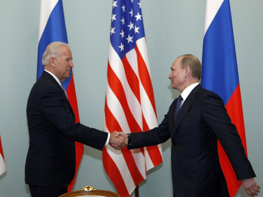 Then-Vice President Joe Biden shakes hands with then-Russian Prime Minister Vladimir Putin in Moscow, March 10, 2011. Biden has said he once told Putin he looked into his eyes and didn't see a soul.