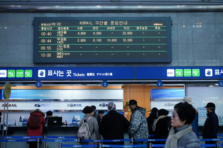 Signs for the DMZ train above ticket windows at the Yongsan Station in Seoul.