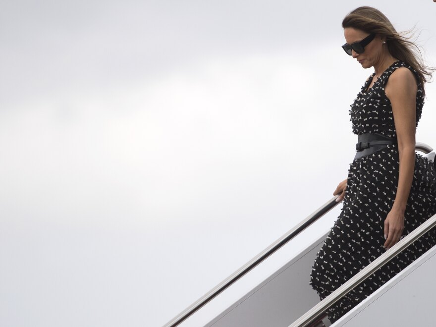 First lady Melania Trump arrives in West Palm Beach, Fla., last week. On Wednesday, she reached a deal to settle defamation claims over an article published in the <em>Daily Mail</em> tabloid about her time as a model.
