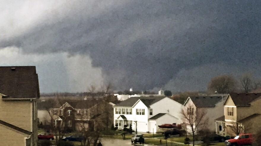 A tornado is viewed near Pearl Street from a home in Kirkland, Ill., Thursday. One person was killed in the tiny community of Fairdale, officials said.
