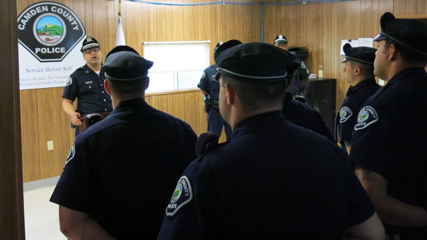 Camden County Police line up for morning roll call at a trailer used for the department's northern division office. Police Chief Scott Thomson says in addition to the downtown headquarters, he wanted to extend the department out into the community, with two offices located closer to where people live.