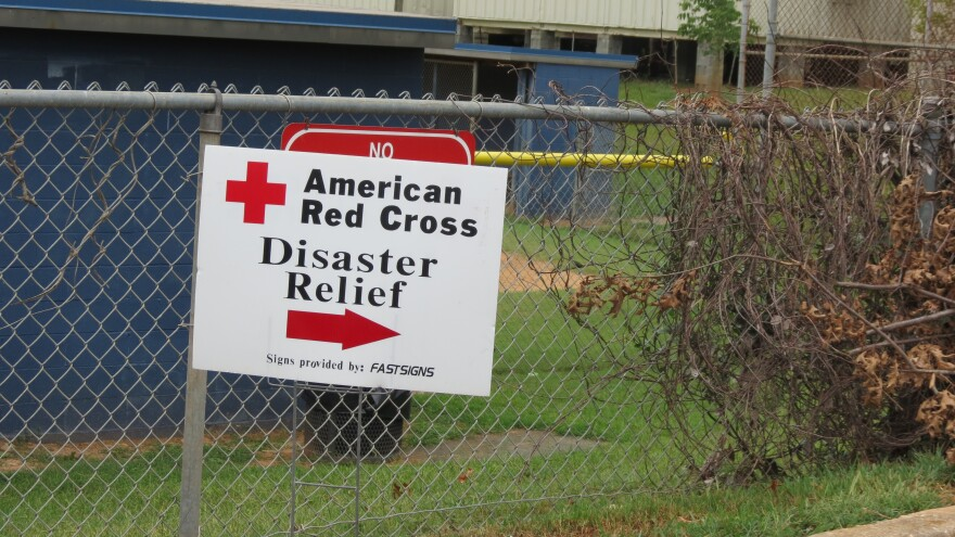 Signs lead people to Red Cross hurricane shelter at East Meck High