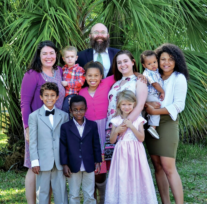 """We would not be able to foster without Medicaid,"" says Sherri Croom of Tallahassee, Fla. Croom and her husband, Thomas, have fostered 27 children in the past decade. They're pictured here with four adopted children, two 18-year-old former foster daughters and those daughters' sons."