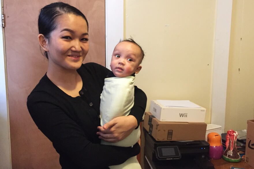 Madina Tagasheva, holding her 4-month-old son, Kareem, plans to apply for one of the new deferred action programs if they are approved by the courts.
