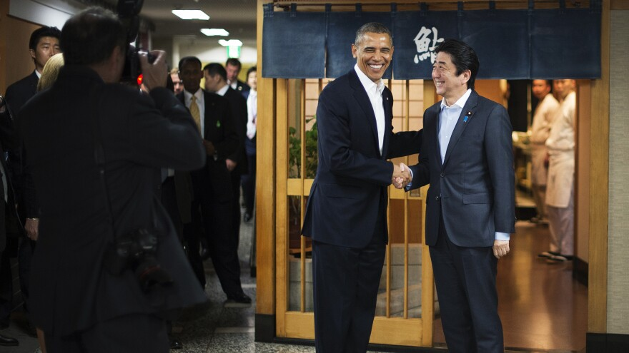 President Obama shakes hands with Japanese Prime Minister Shinzo Abe before a private dinner at Sukiyabashi Jiro in Tokyo on Wednesday. At Sukiyabashi Jiro, people pay a minimum of $300 for 20 pieces of sushi chosen by the patron, Jiro Ono.