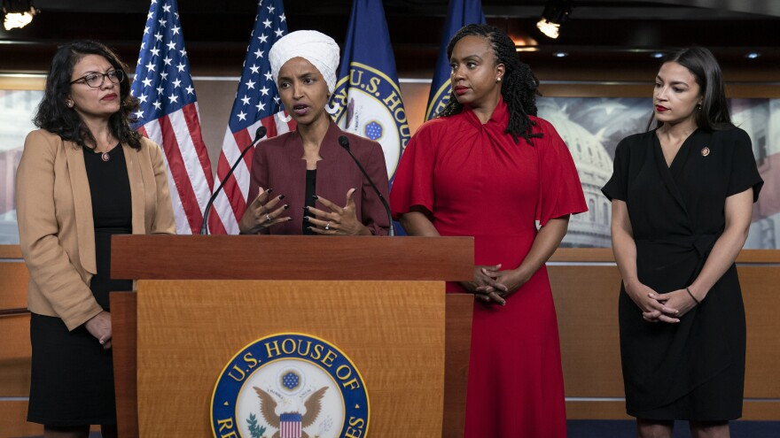 From left, Democratic Reps. Rashida Tlaib of Michigan, Ilhan Omar of Minnesota, Ayanna Pressley of Massachusetts and Alexandria Ocasio-Cortez of New York respond to attacks by President Trump in a press conference on Monday. The House passed a resolution condemning his comments on Tuesday.