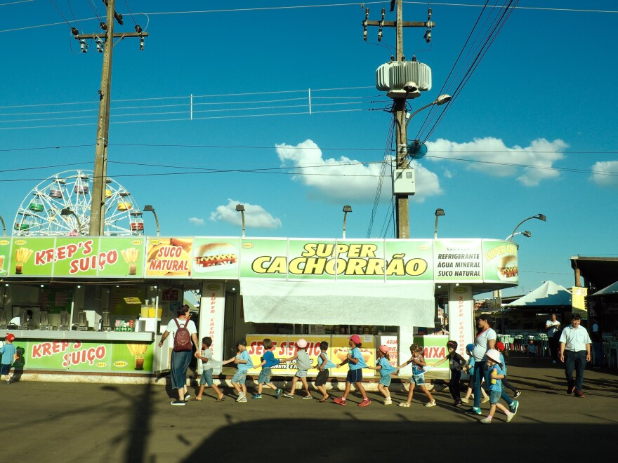 Children visit the food stall section of Expo Londrina, an agricultural fair in the southern Brazilian city.