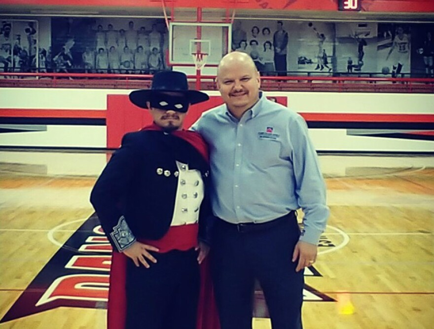 San Antonio College President Robert Vela, right, poses for a photo with Antonio the Masked Ranger during a pep rally Oct. 9, 2019 introducing students to the mascot.