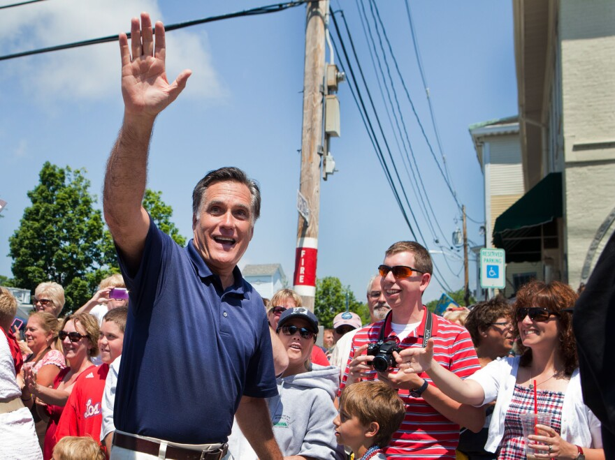 Republican presidential candidate Mitt Romney participates during the Wolfeboro, N.H., Independence Day parade on Wednesday.