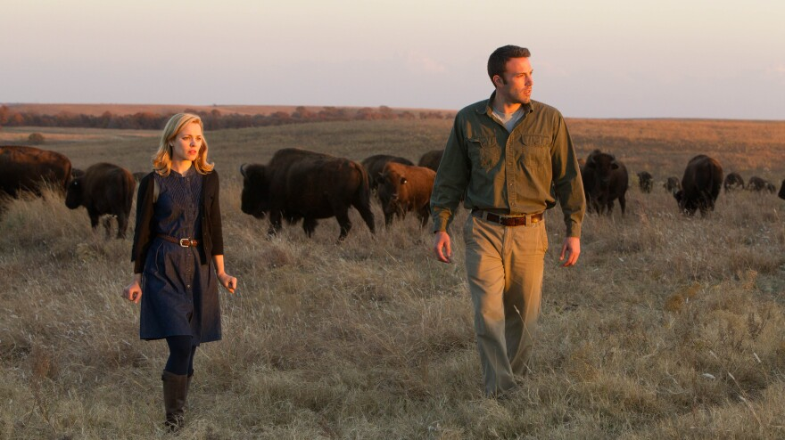 Jane (Rachel McAdams) rekindles an old affair with the taciturn Neil (Ben Affleck), an environmental investigator whose work takes him to a remote Oklahoma town in the enigmatic new film <em>To the Wonder</em>.