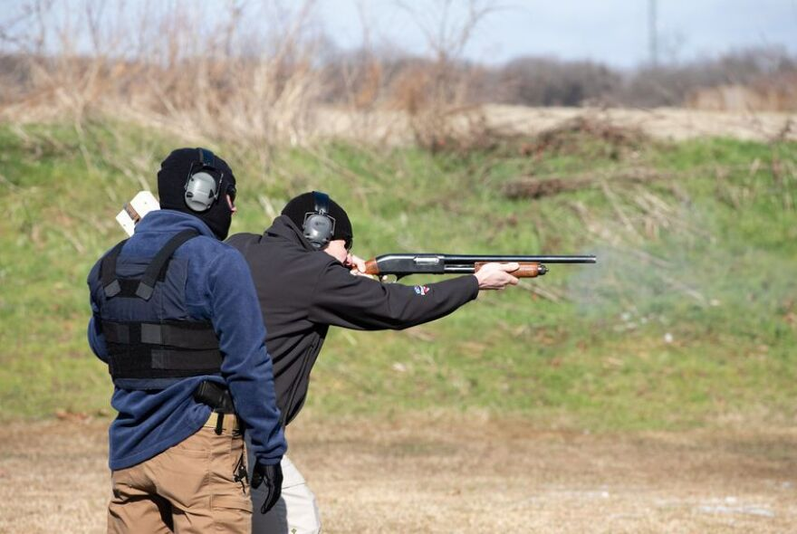 A member of the church security team fires at a target at a shooting range in Krugerville.