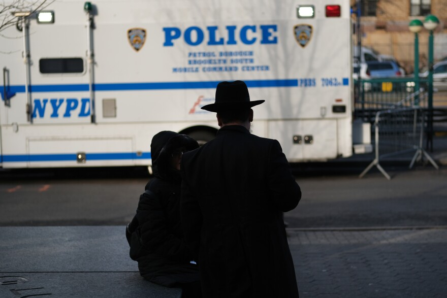 People walk through the Orthodox Jewish section of a Brooklyn neighborhood last month. Tensions remain high in Jewish communities following a series of attacks and incidents in recent weeks.