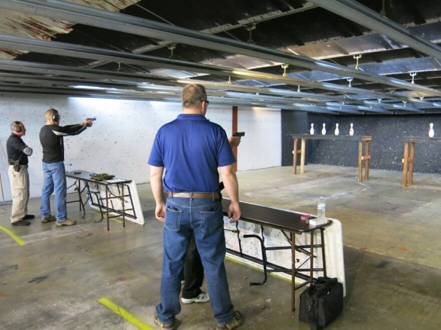 Shooters take aim on Monday Night Bowling Pin Shoot at the firing range of the Bristlecone Shooting, Training and Retail Center in Lakewood, Colo.